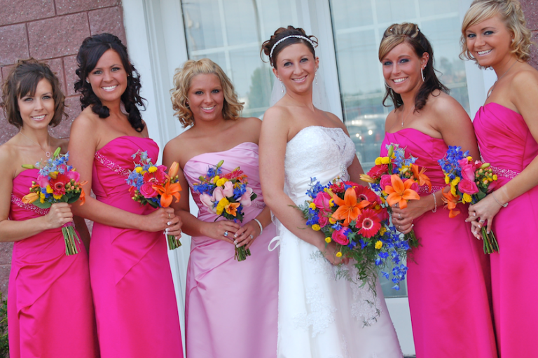 bridesmaids at wedding dressed in pink