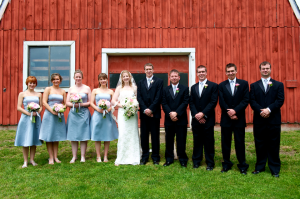 bridal party in front of barn at wedding