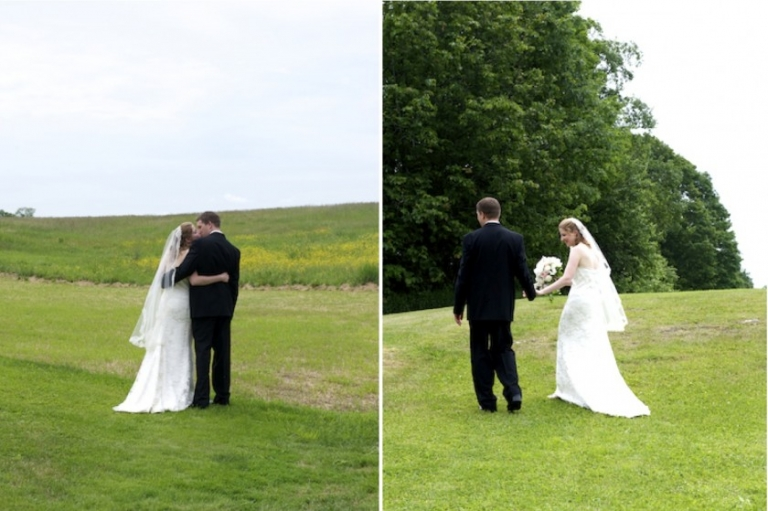 couple walk in field after wedding