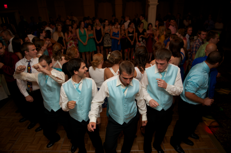 groomsmen play game at reception for garder