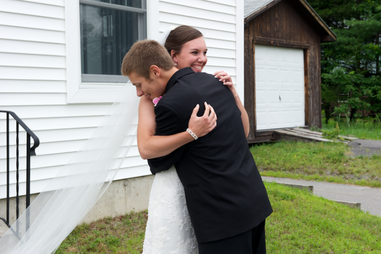 groom hugs bride after seeing her for first time