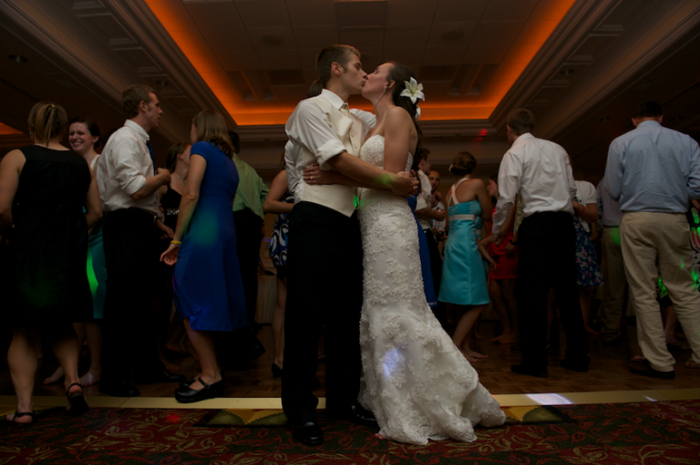 bride and groom kiss at Maine wedding reception