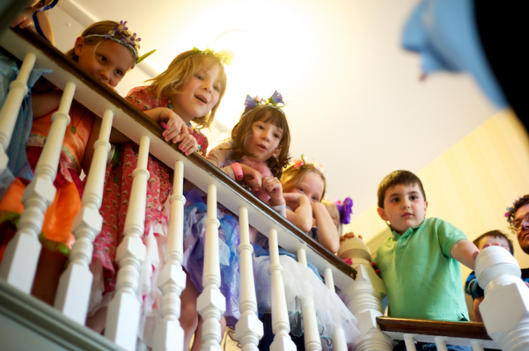 children looking over the banister