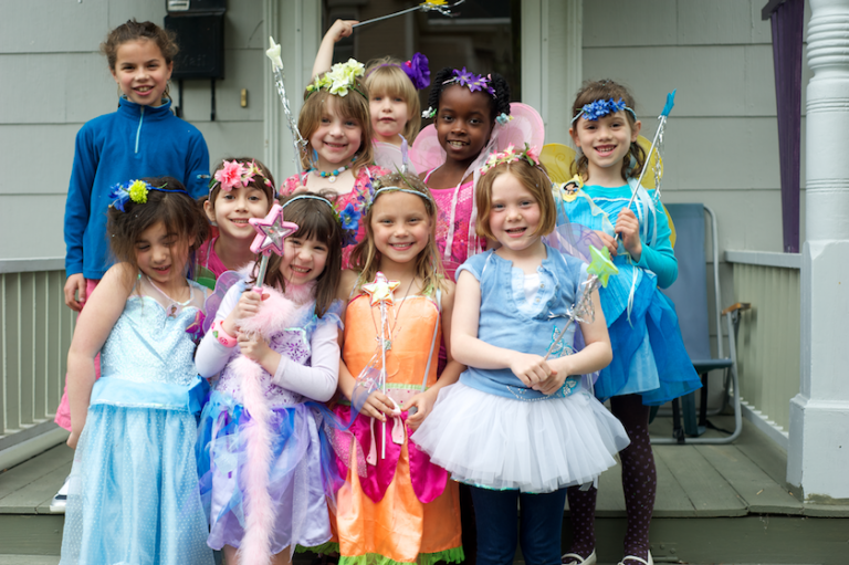 children on the front porch in their fairy costumes