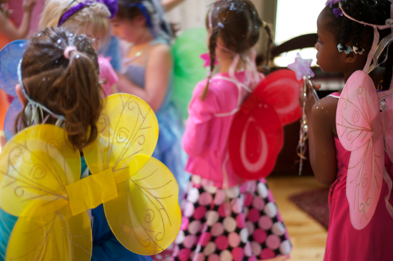children wearing their fairy wings