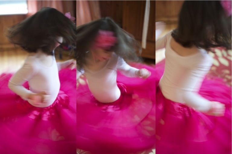 twirling in a pink ruffled skirt