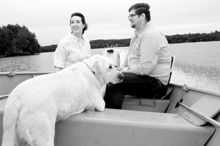 Maine wedding couple on a boat in Maine lake