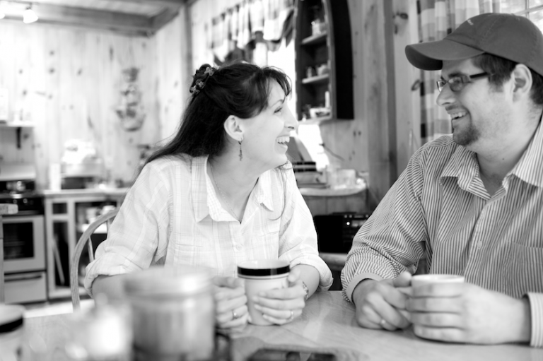 Maine bride and groom drink coffee at camp