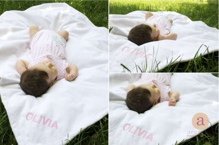 baby laying on monogramed blanket