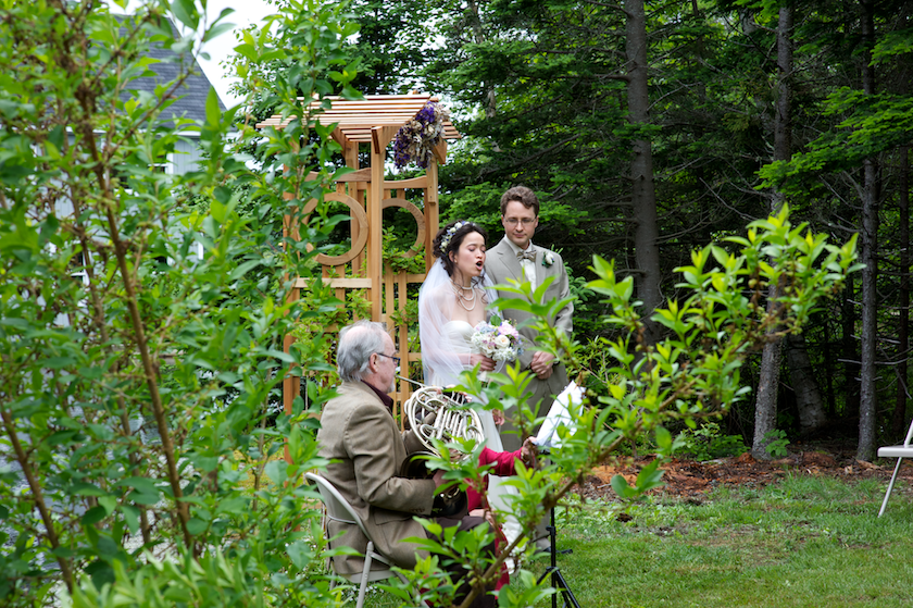 bride sings a song during ceremony