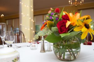 fall colored flowers on tables