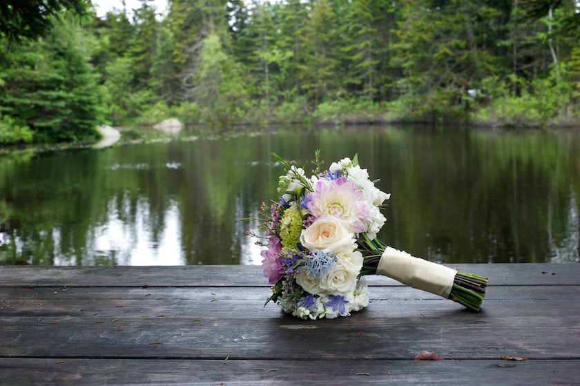 bouquet on picnic table at pond