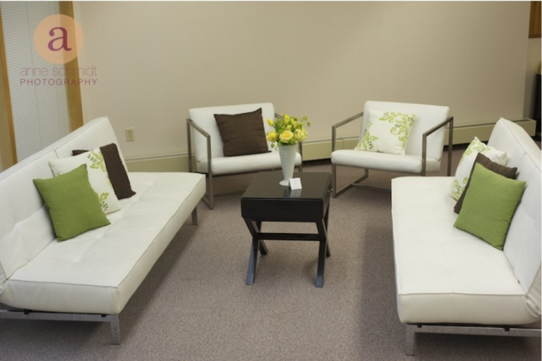 white couches with yellow floral arrangement