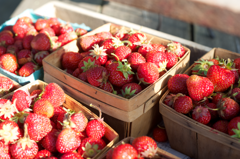 strawberries in wooden boxes