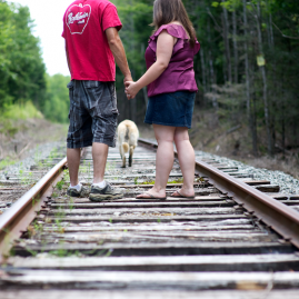 engagement photo on Maine railroad tracks