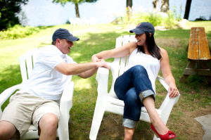 Maine lakefront engagement session wearing Yankees Red Sox hate