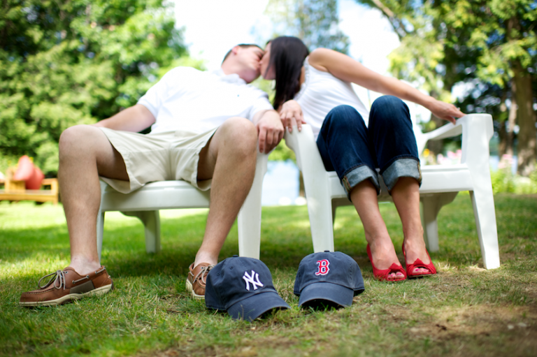 Kissing couple with baseball caps