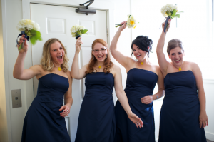 bridesmaids wear navy blue and yellow