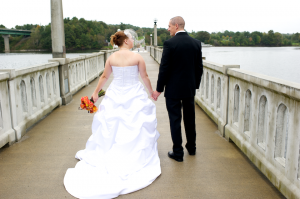 Maine wedding bride and groom take walk on bridge