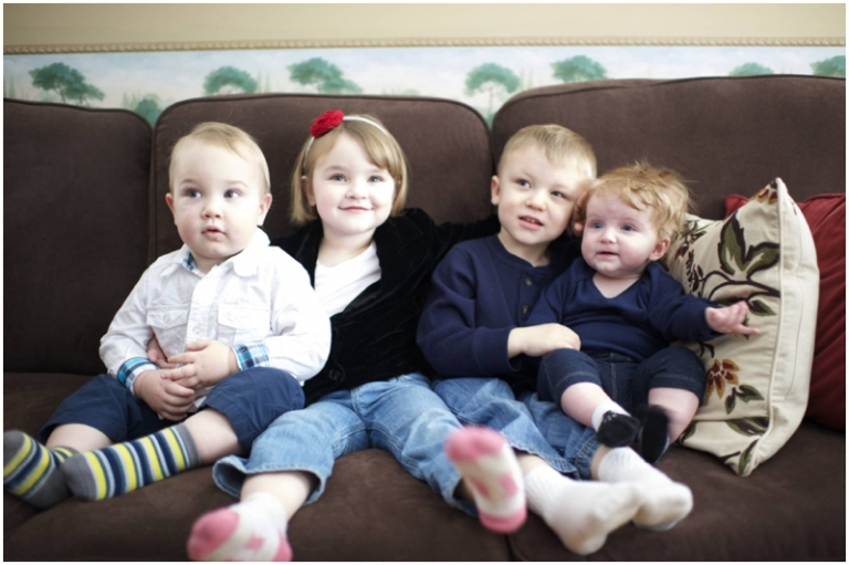 grandchildren on the couch for family photo by Maine family photographer Anne Schmidt