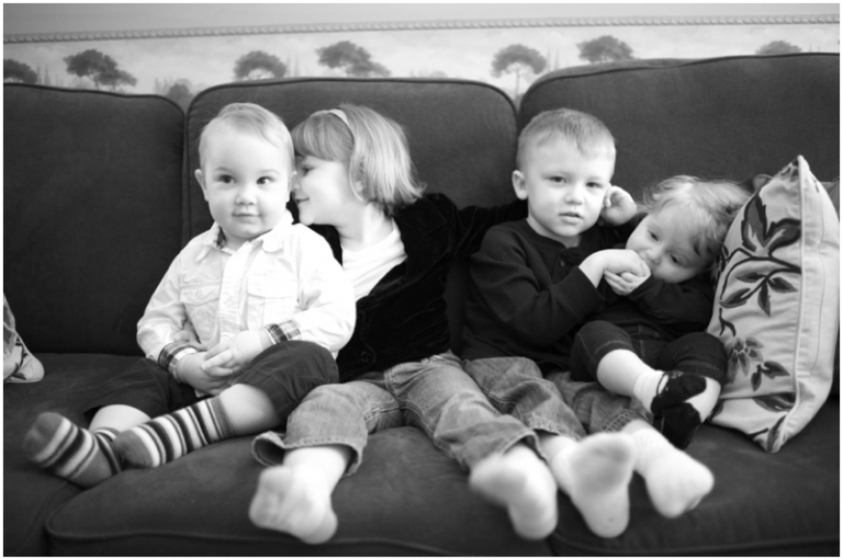 grandkids snuggle on the couch