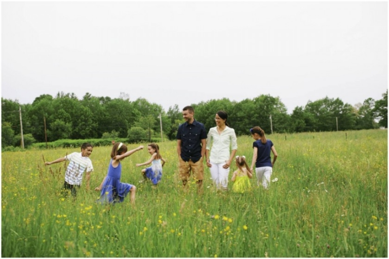 family photos of kids running in a field of buttercups