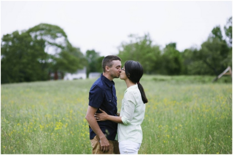 parents in the field kissing