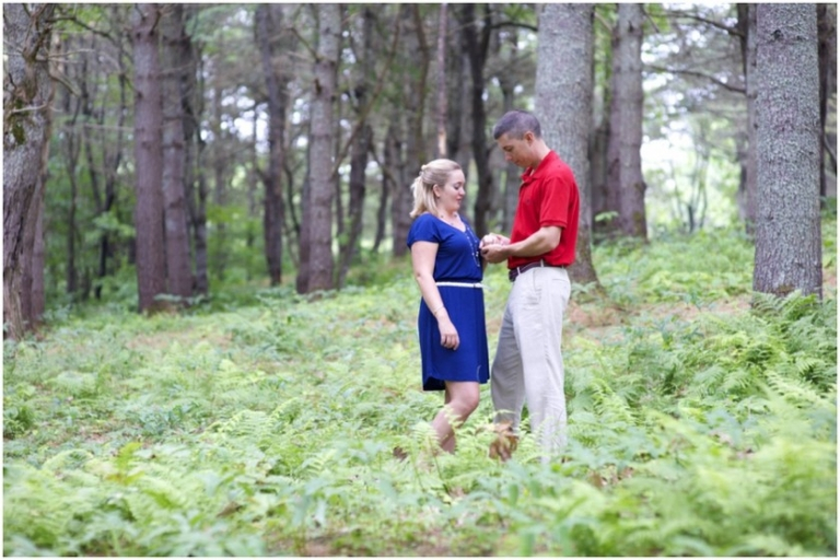 engagement photos surrounded by ferns