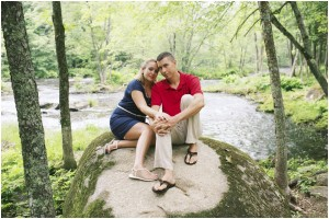 engagement photos on a rock by the river