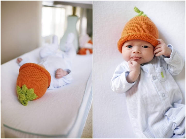 baby wearing pumpkin hat