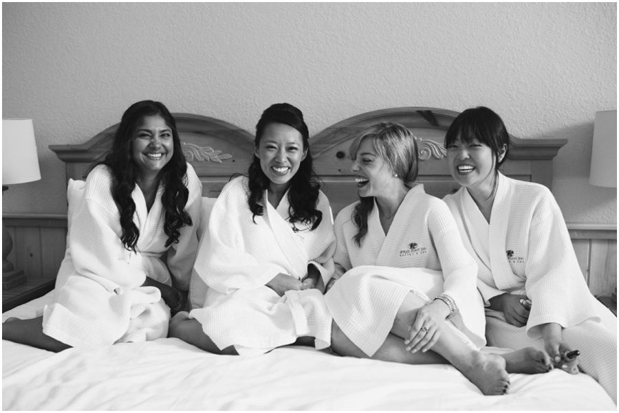 bridesmaids on bed at Sprucepoint Inn