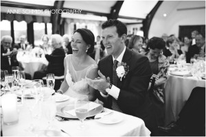 laughing couple wedding reception toasts